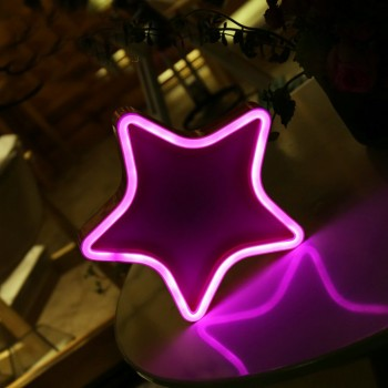 Decorative neon lamp with a pink Star shape